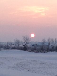 Sunset over the snow in Wheatland County Alberta