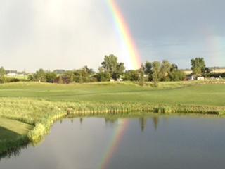 Rainbow Alberta over real estate